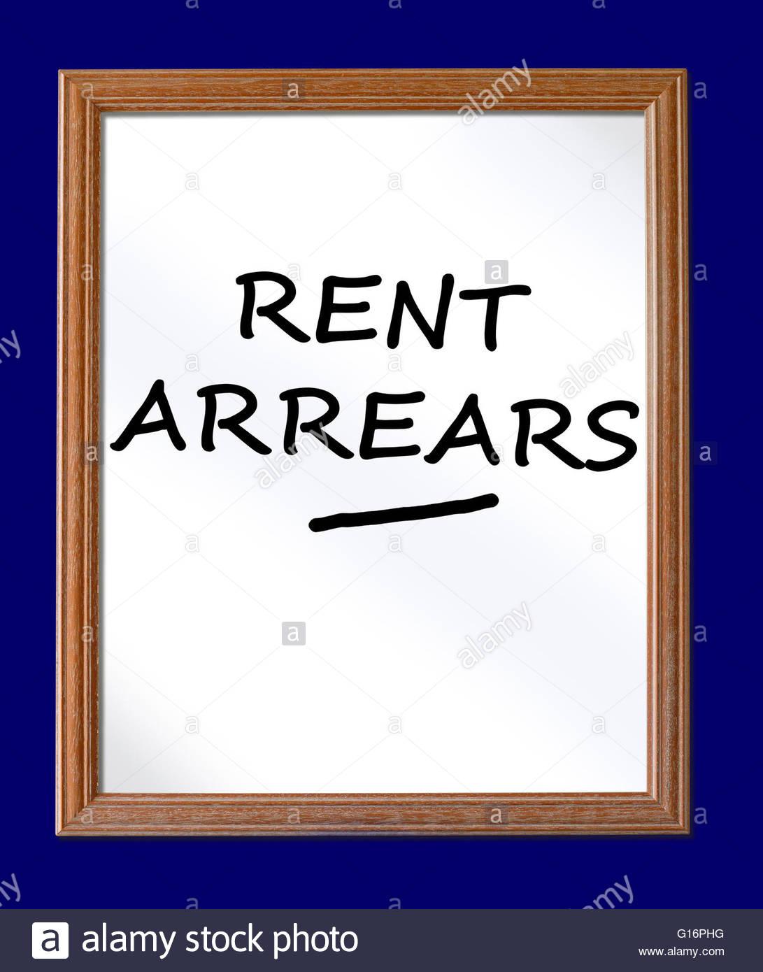 Rent arrears written on a chalkboard, Dorset, England, UK - Stock Image