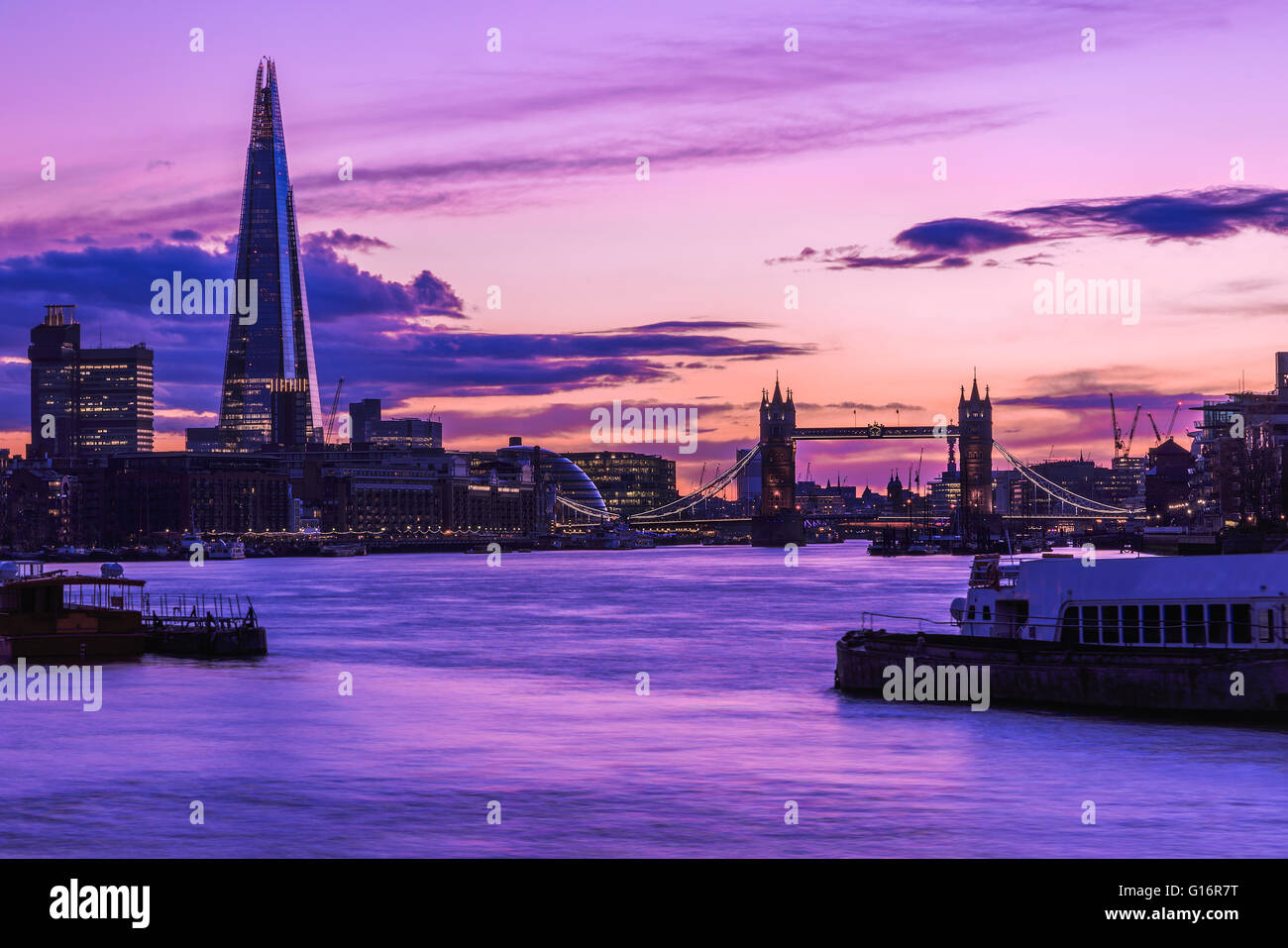 Modern London cityscape during sunset - Stock Image