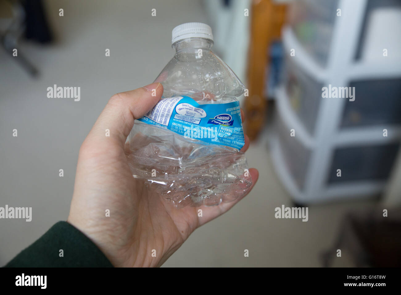 Crumpled Plastic Bottle squeezed water bottle - Stock Image