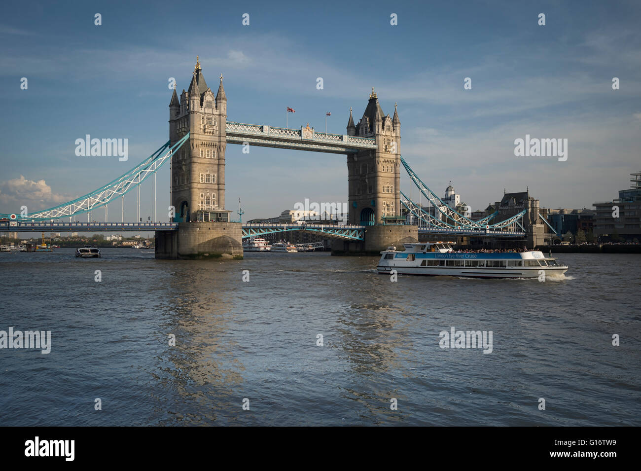 Tower Bridge, London with river cruise on the River Thames - Stock Image