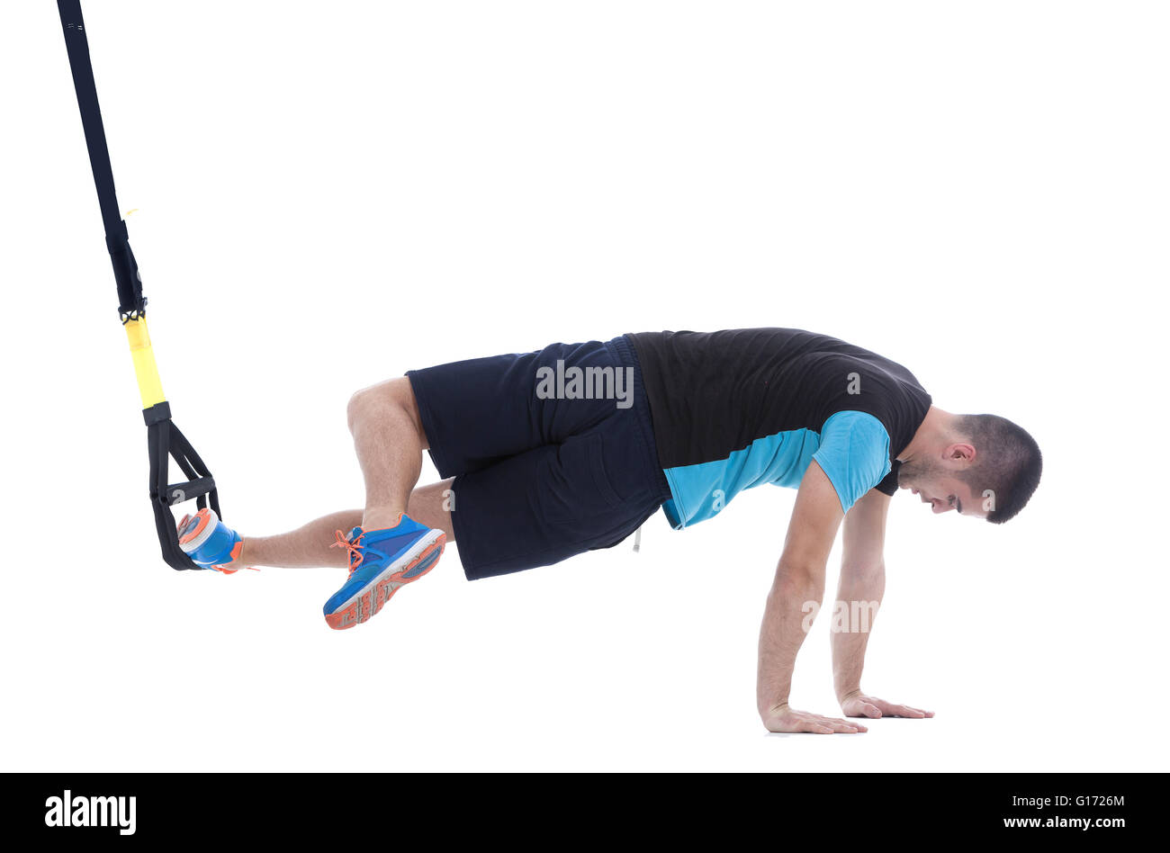 Athletic trainer on functional loops for training isolated on white background. Stock Photo