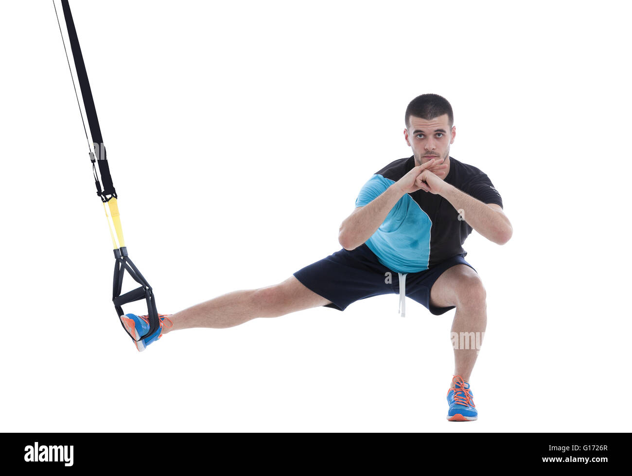 Athletic trainer on functional loops for training isolated on white background. - Stock Image