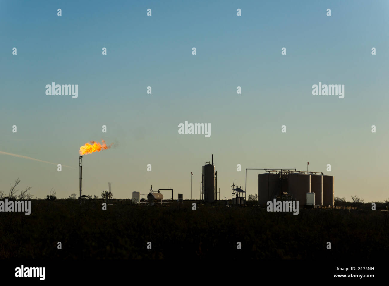 Gas flaring from a well in West Texas. - Stock Image