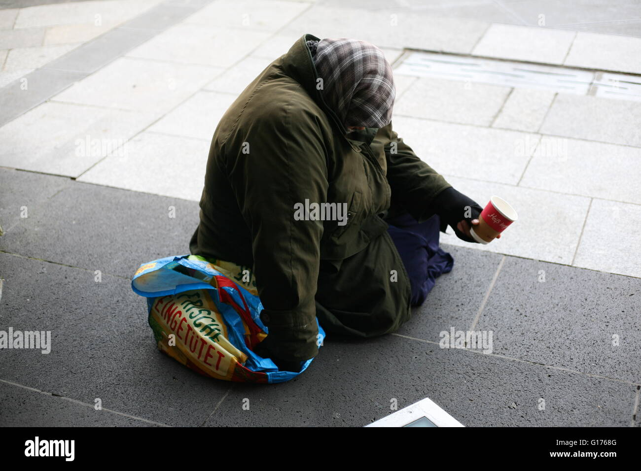 begging women at the entrance of the Dom in Cologne, Germany - Stock Image