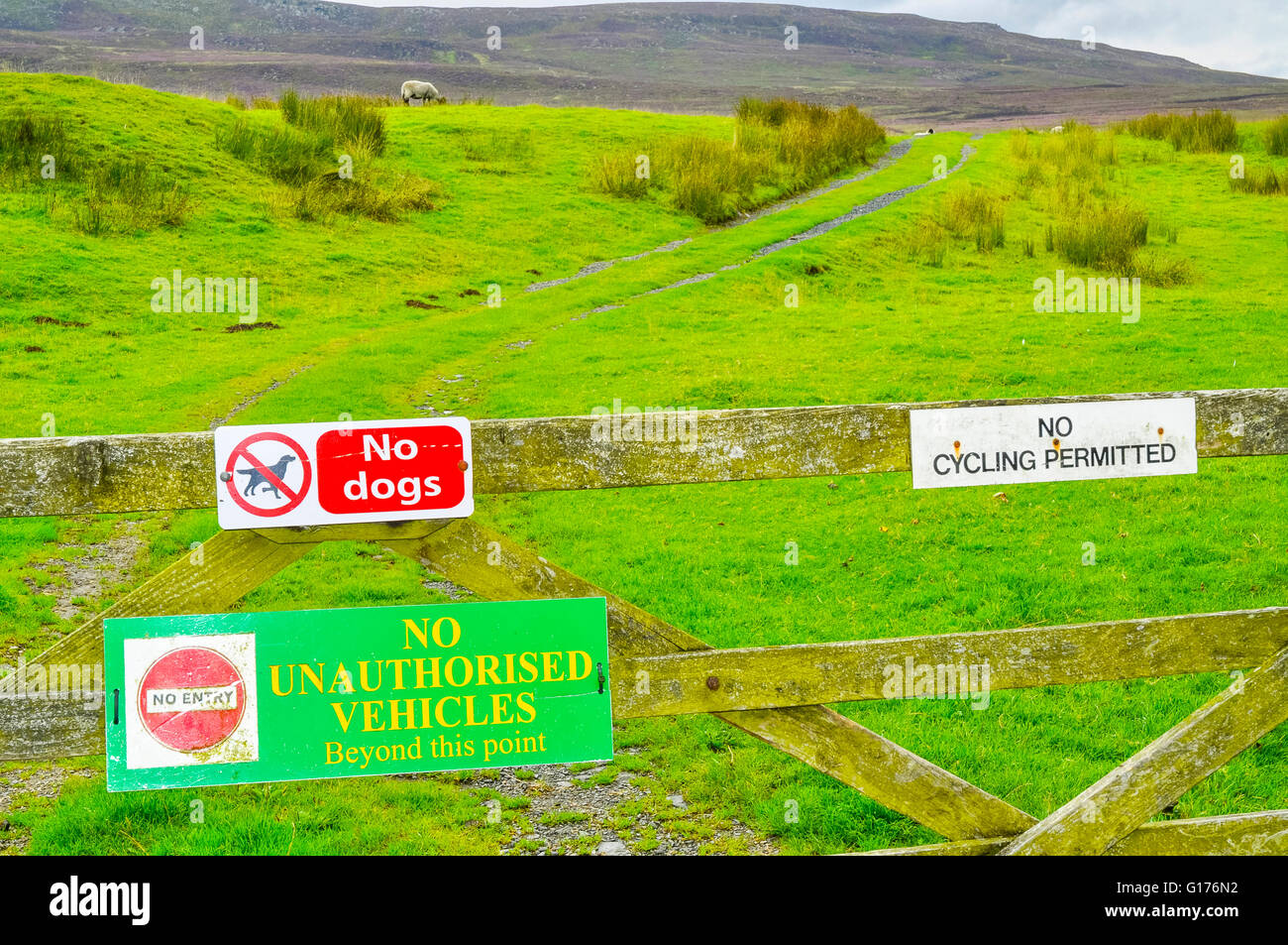 Restrictive signs on gate at Tarnbrook in the Forest of Bowland Lancashire England - Stock Image