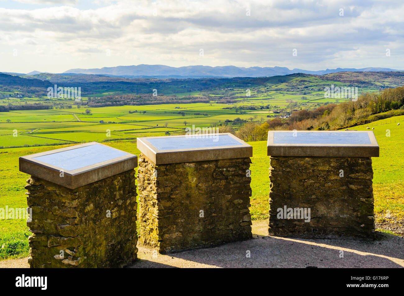 View indicator at Helsington church looking over the Lyth Valley to the high fells in the Lake District National - Stock Image