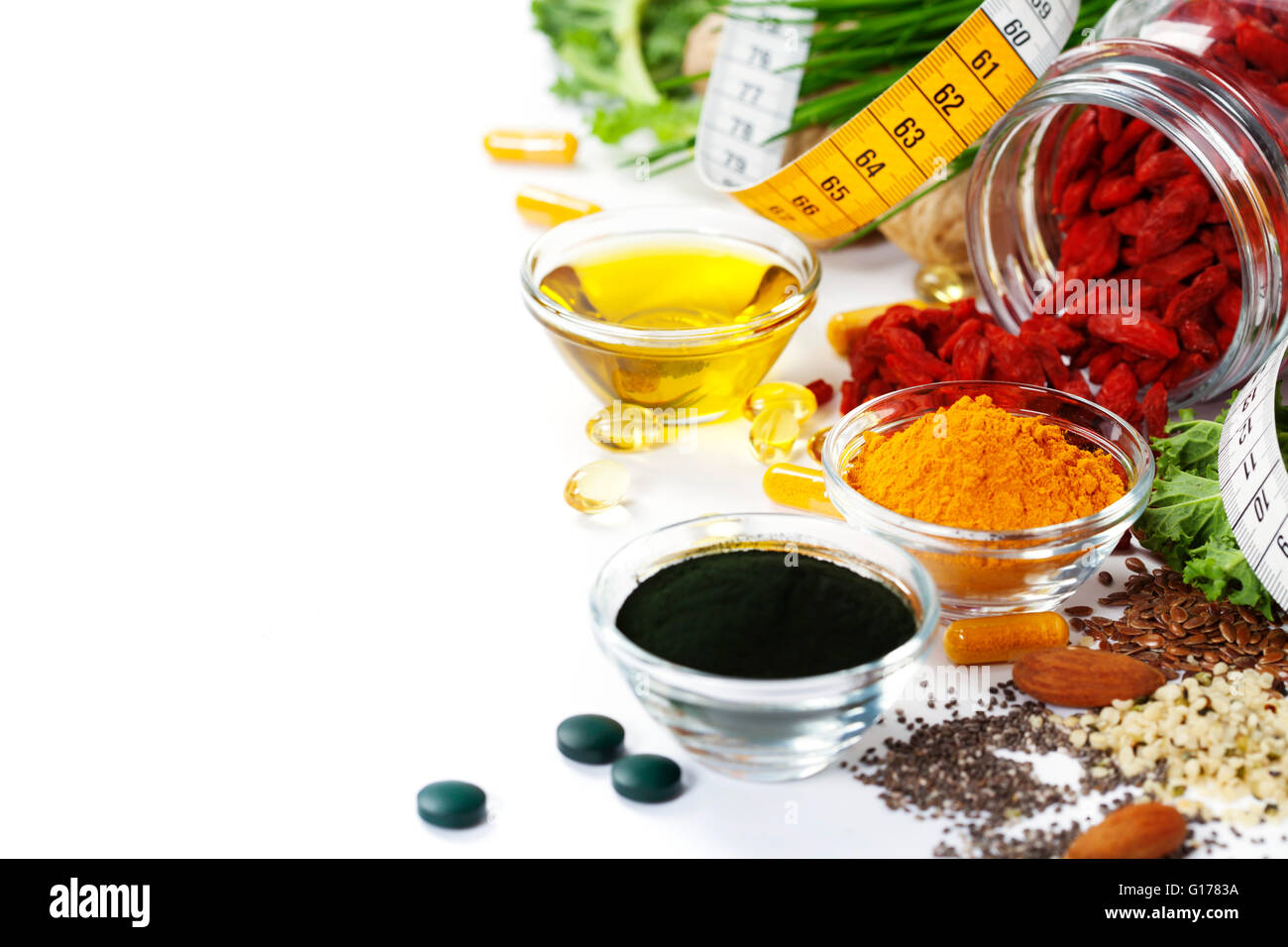 Alternative natural medicine. Dietary supplements. Spirulina, turmeric  and organic oil on white background. Superfood, - Stock Image