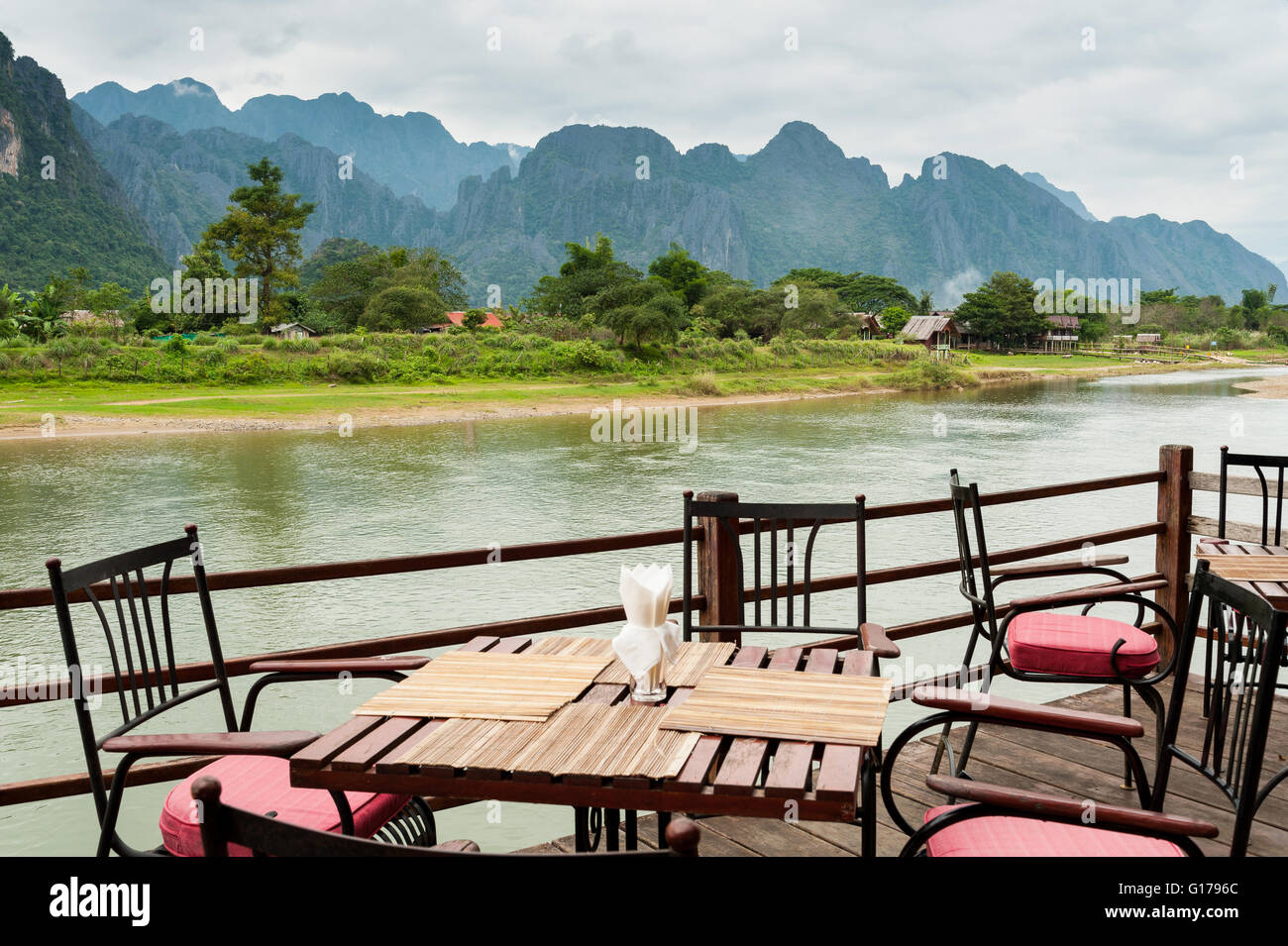 view of Nam Song River with Dining Table at Vang Vieng, Laos - Stock Image
