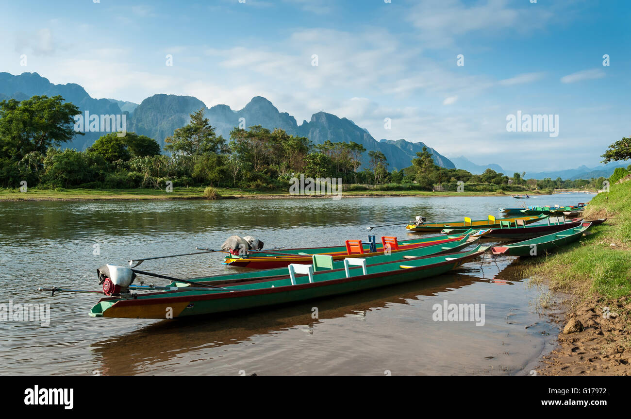 long tail boats on Song river, Vang Vieng,Laos. - Stock Image