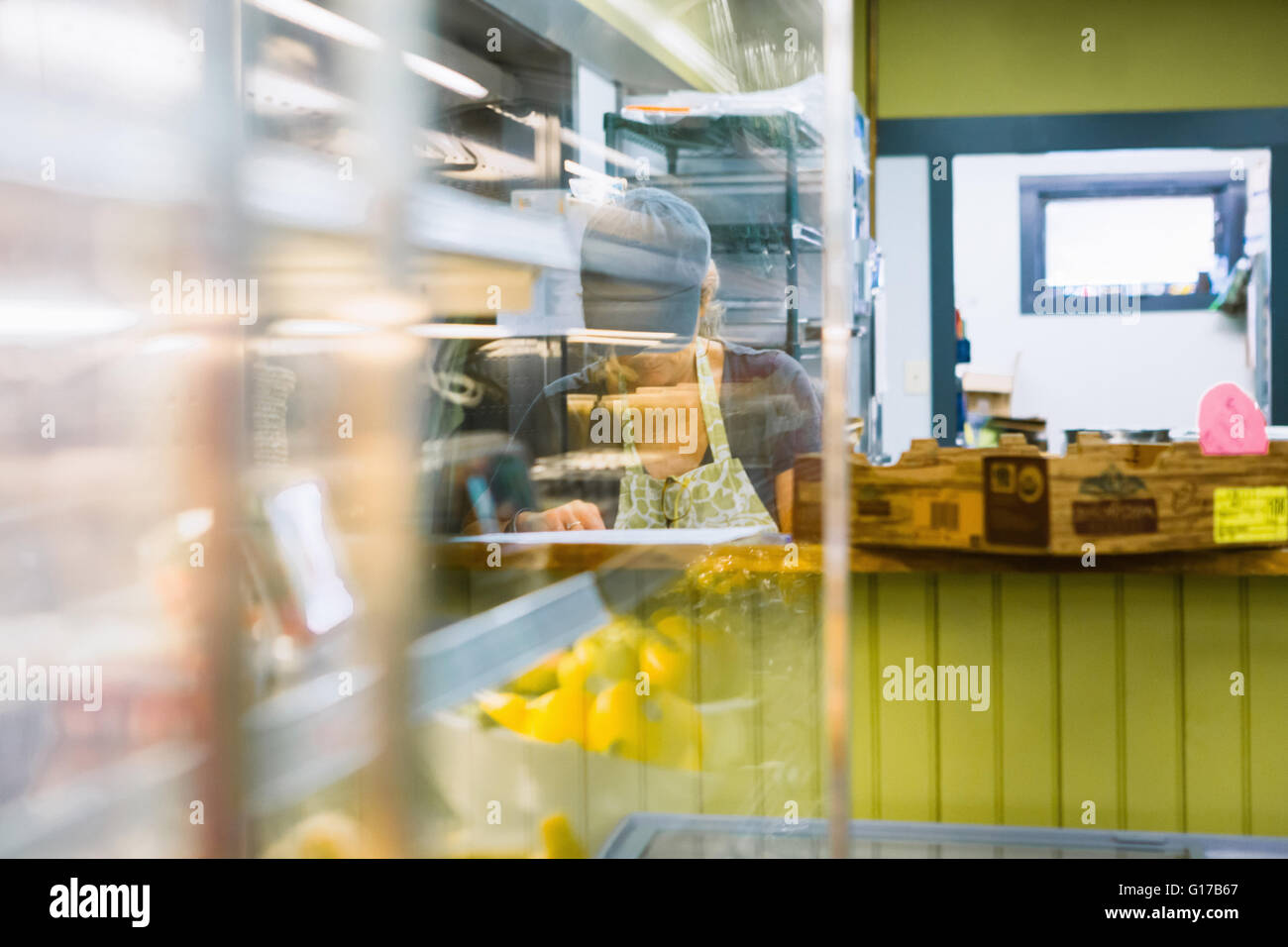 Clerk in general store - Stock Image