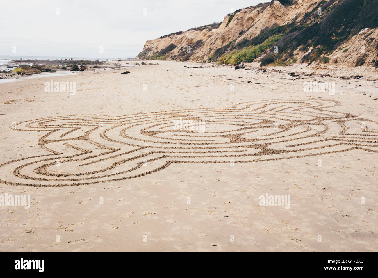 Line drawing pattern drawn onto beach sand, Crystal Cove State Park, Laguna Beach, California, USA - Stock Image