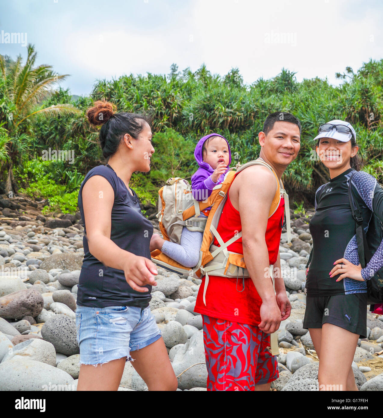Hikers with baby at Hanakapiai Beach, reached by hiking  the Kalalau Trail - Stock Image