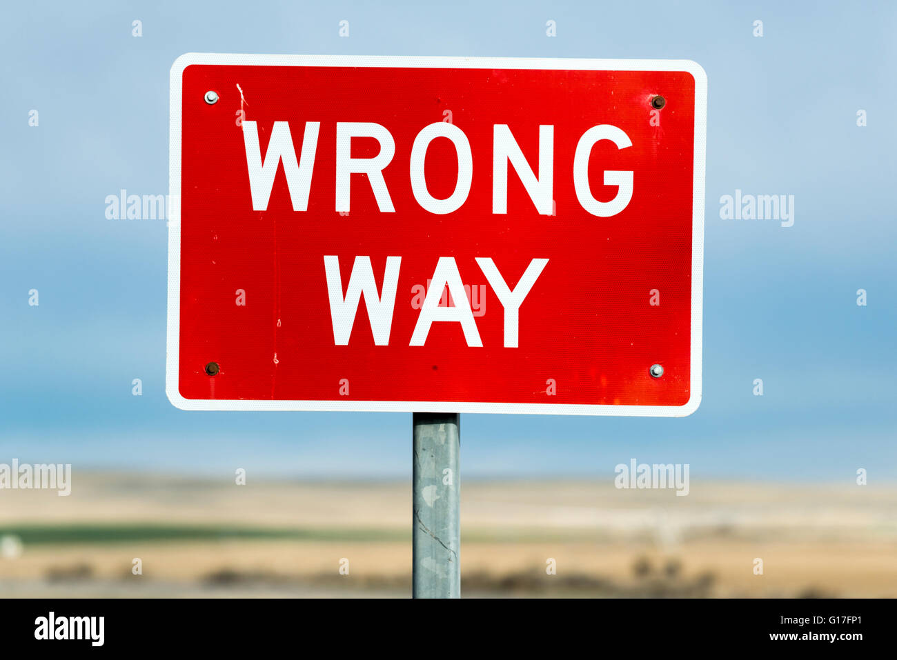 Wrong way sign by a highway in Idaho. - Stock Image