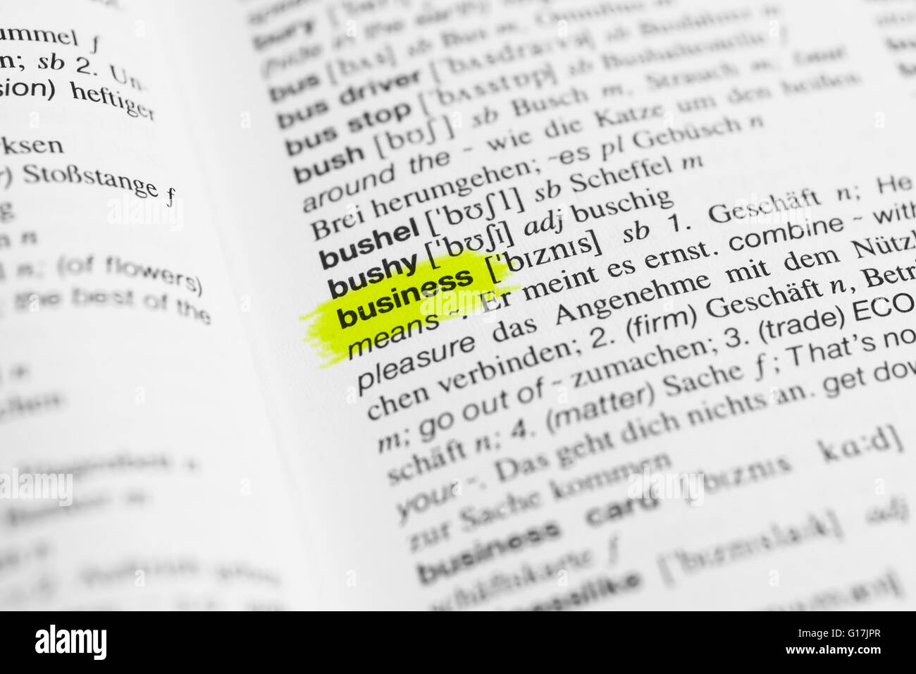Detail of English word 'business' and its german translation from dictionary - Stock Image