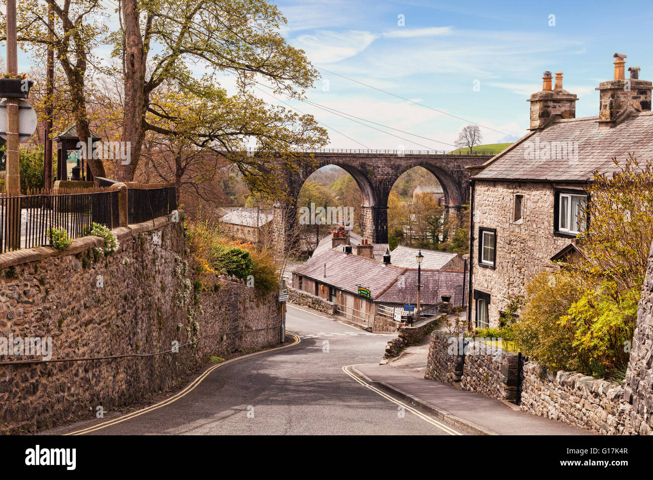 The village of Ingleton, with its cottages and railway viaduct, Yorkshire Dales National Park, North Yorkshire, - Stock Image