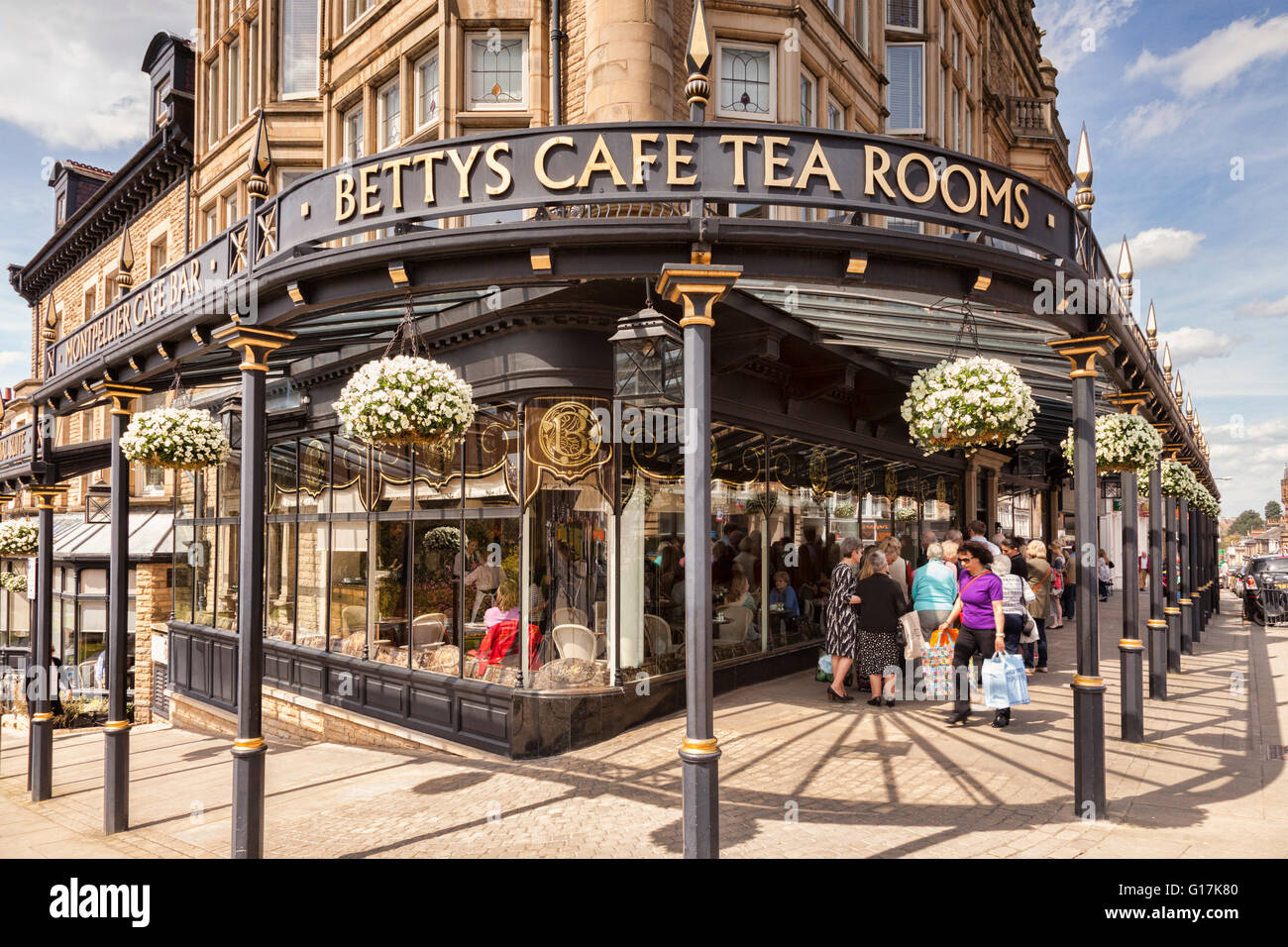 Bettys Cafe Tea Rooms, Harrogate, North Yorkshire, England, UK, and a queue waiting outside to go in. - Stock Image