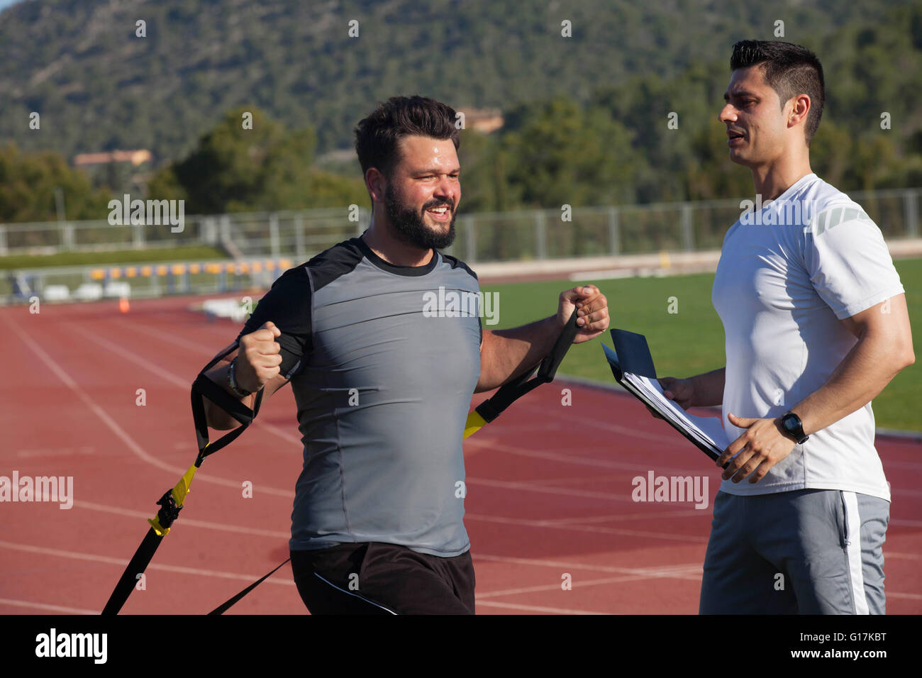 personal trainer workout fitness session - Stock Image
