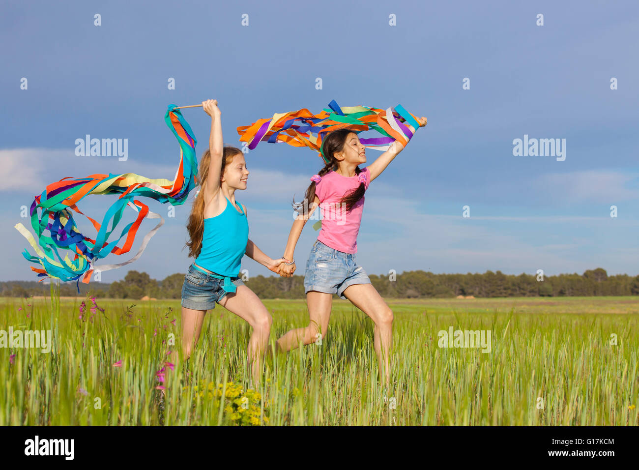 healthy happy kids fun  playing outdoors - Stock Image