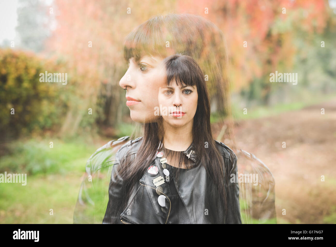 Double image of young woman outdoors - Stock Image