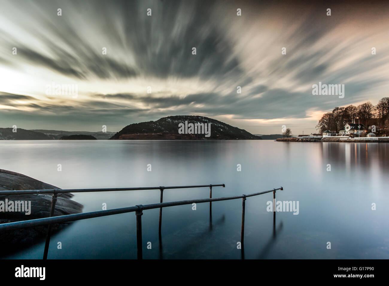 Railings submerged in water, Oscarsborg, Drobak, Norway - Stock Image