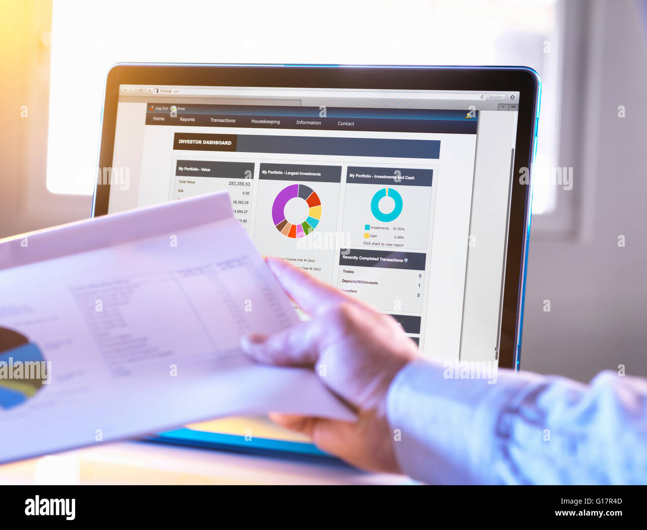 Man viewing online portfolio of investments for savings and pension - Stock Image