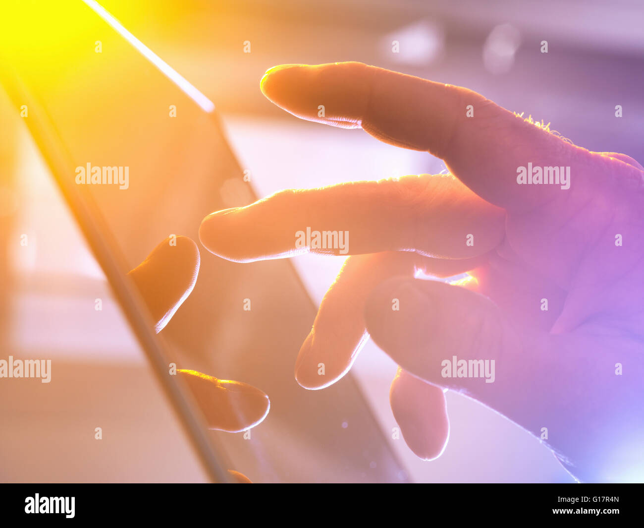 Man using touchscreen device, close-up - Stock Image