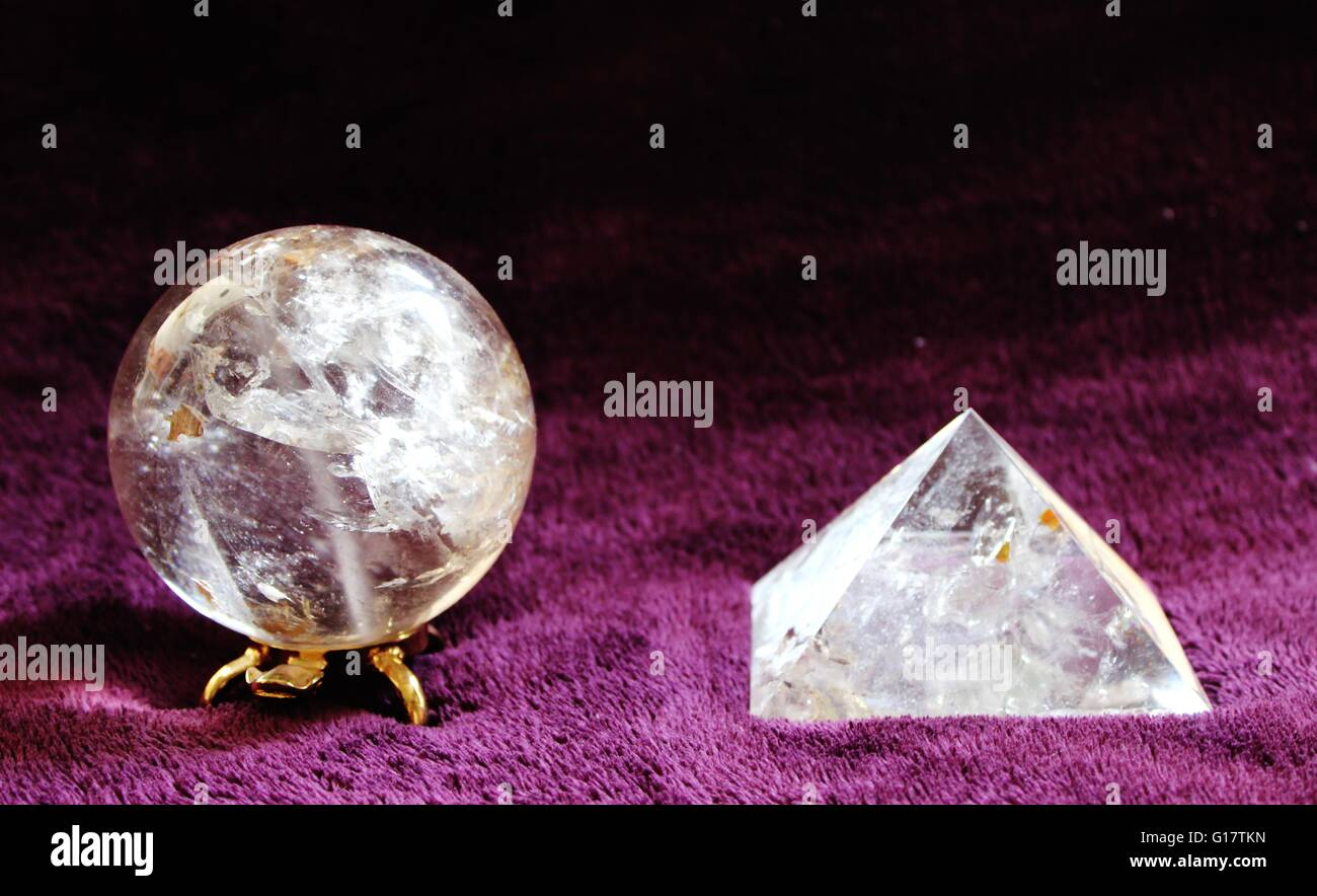 clear quartz crystal sphere and pyramid Stock Photo