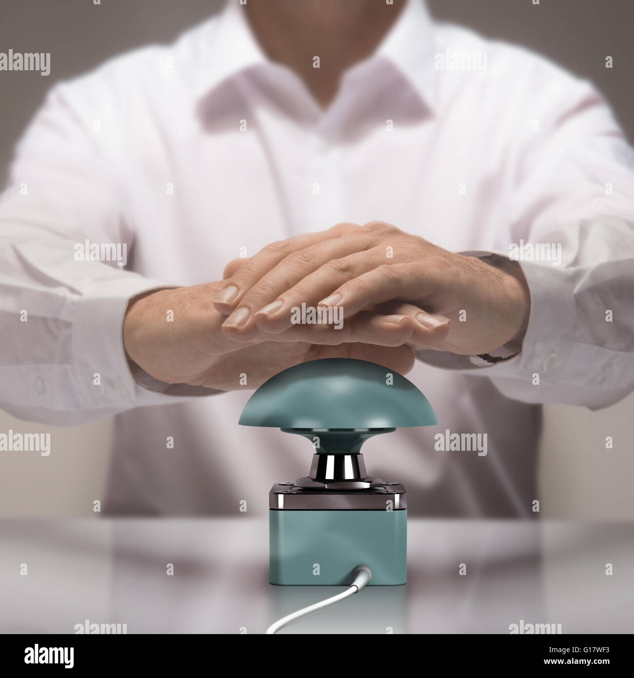Image compositing between photography and 3D busser. Man with two hands about to press the button for answering - Stock Image