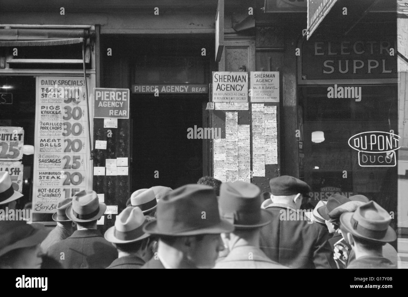 Men Waiting outside Employment Agency, Sixth Avenue, New York City, New York, USA, Arthur Rothstein for Farm Security - Stock Image