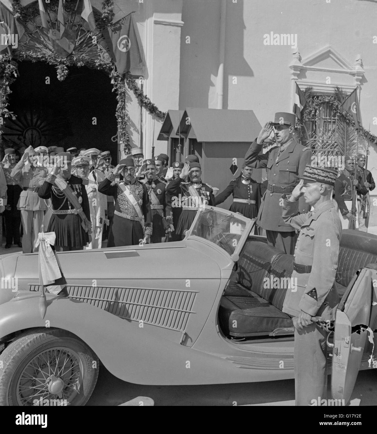 General Charles de Gaulle, Accompanied by General Charles Mast, Saluting as Band Plays Marseillaise Outside Summer - Stock Image