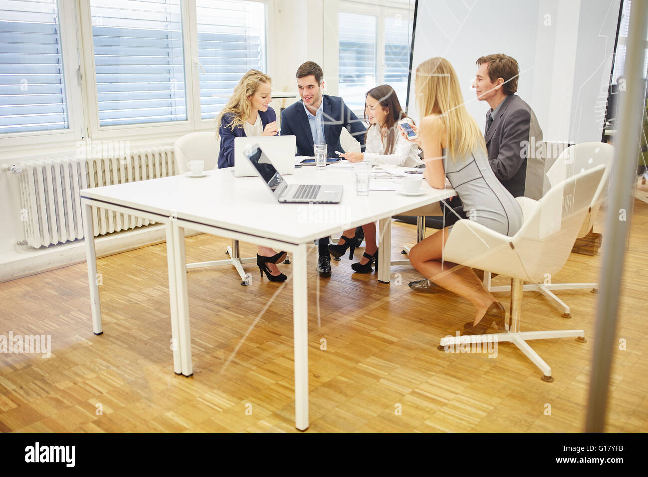 Business people discuss together a strategy in conference room - Stock Image
