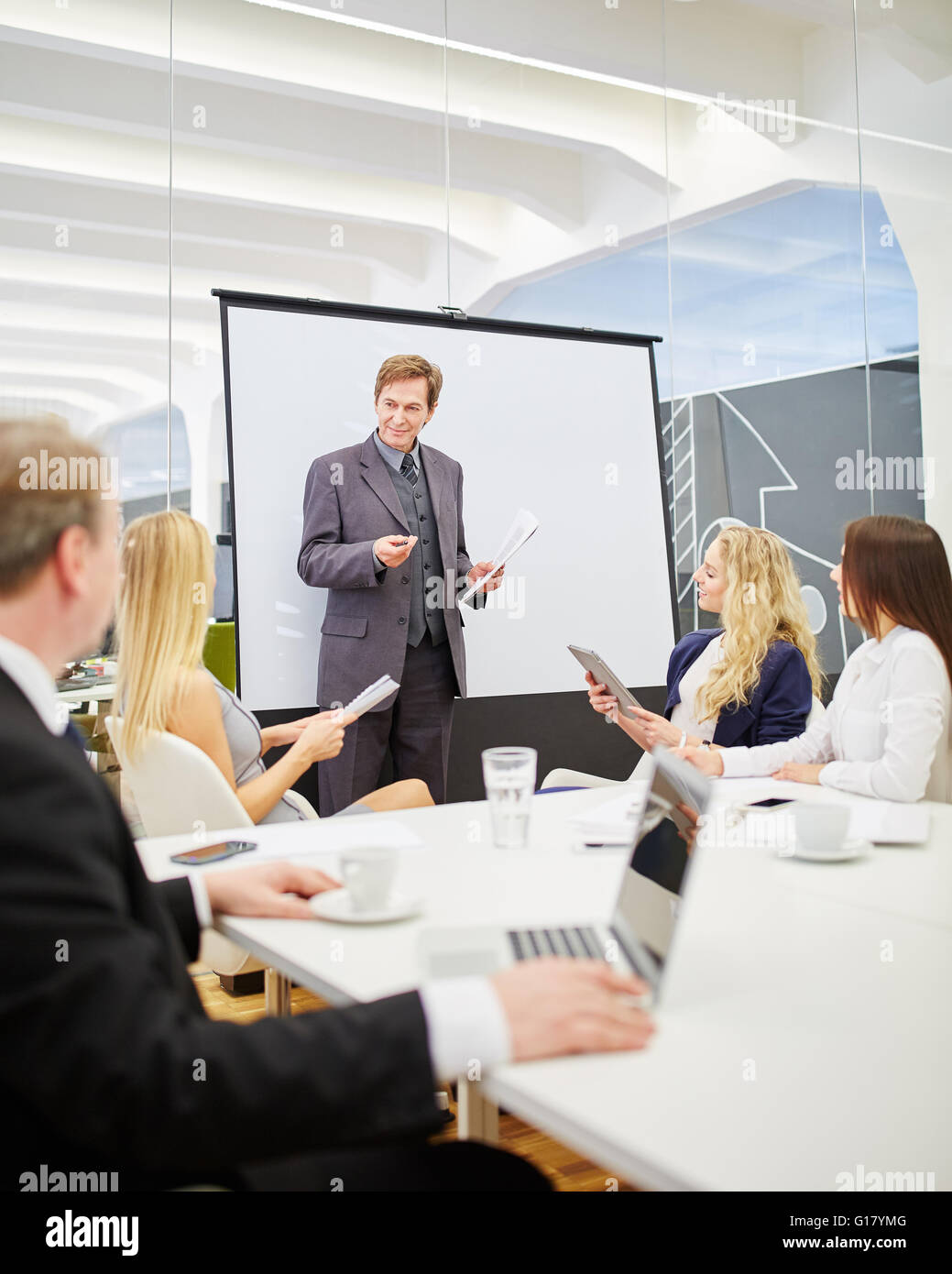 Consultant in a presentation during a business meeting in the conference room - Stock Image
