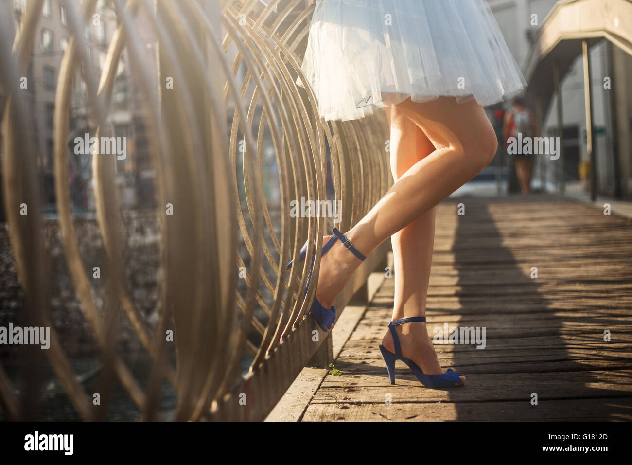 Woman's legs in high heel shoes - Stock Image