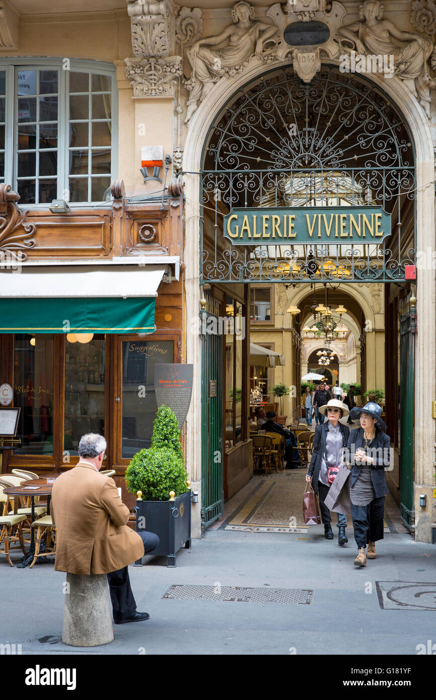 Two Asian tourists exit from Galerie Vivienne, Paris, France - Stock Image