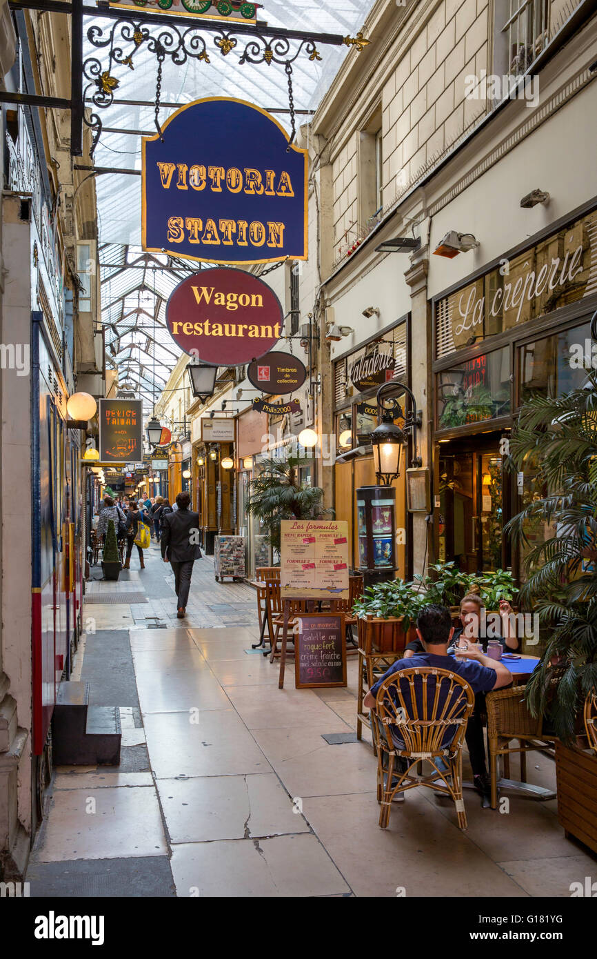 Shops and Cafes in Passage des Panoramas, Paris, France - Stock Image