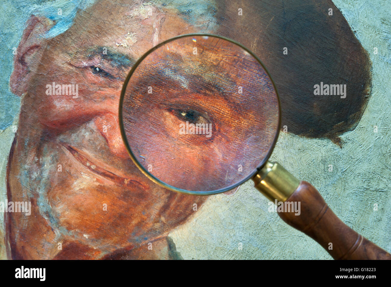 Magnifying glass enlarging detail on eye of original 19th Century Italian oil painting of bright alert happy Neapolitan - Stock Image