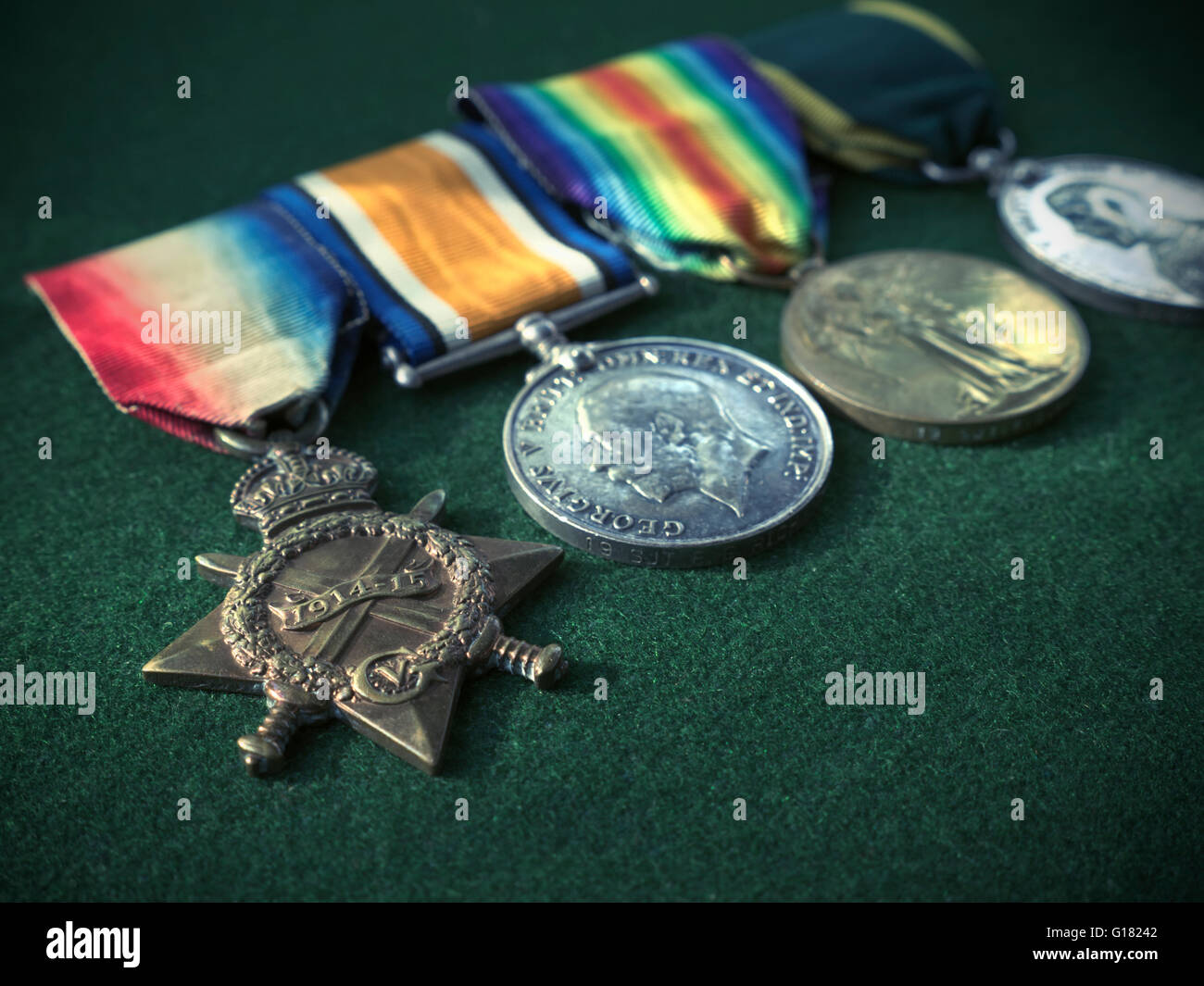 World War One WW1 British soldiers medals and ribbons on green beize surface - Stock Image
