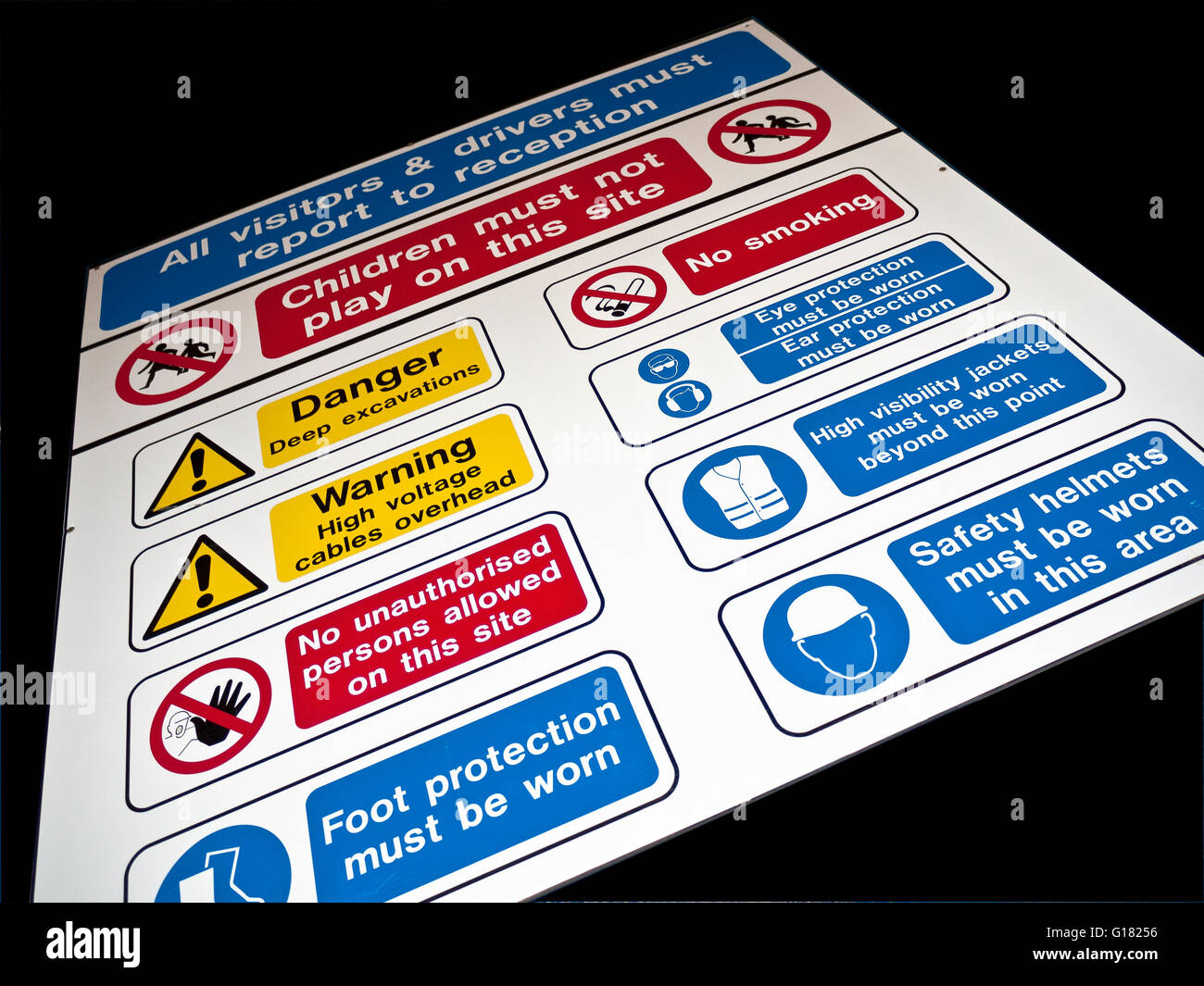 Health and safety hazard signs outside entrance to construction site - Stock Image