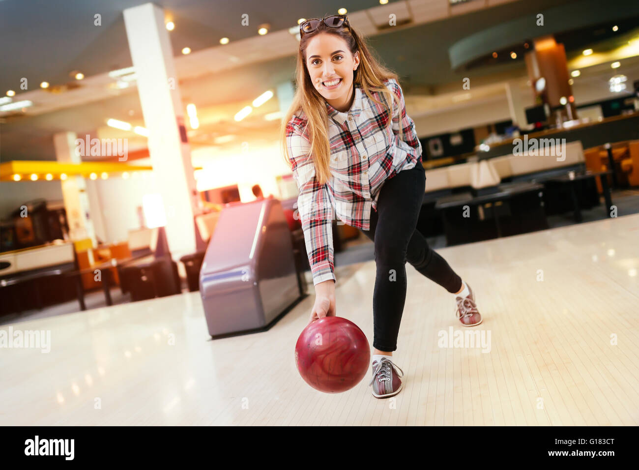 Beautiful woman enjoying  bowling - Stock Image