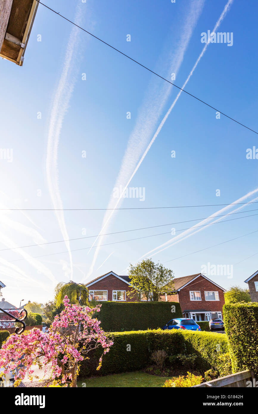 vapor trail trails from plane aircraft airplanes planes trail left in sky  Lincolnshire UK England - Stock Image