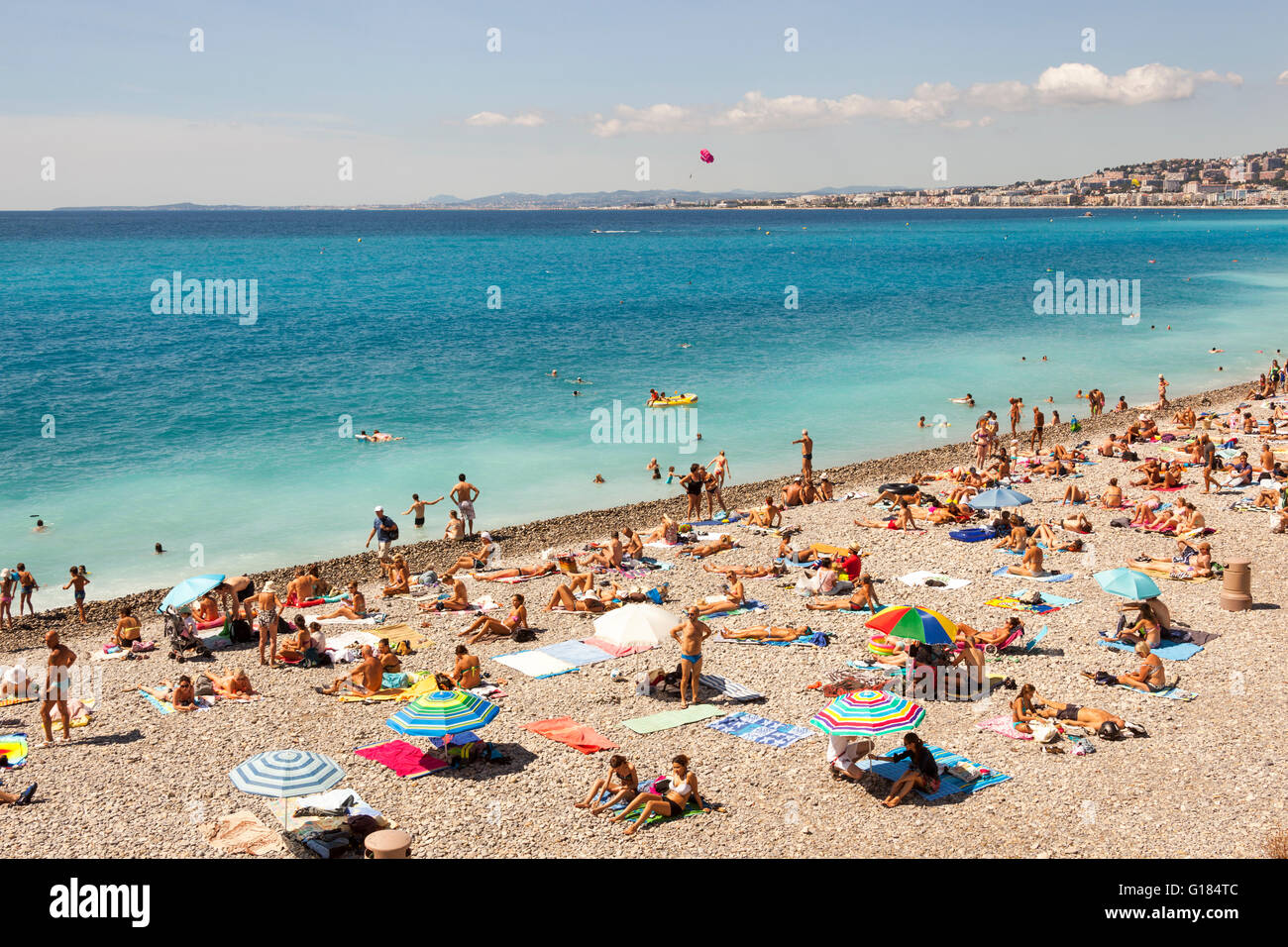 Baie Des Anges and tourists sunbathing on beach, Nice, Cote D'Azur, France Stock Photo