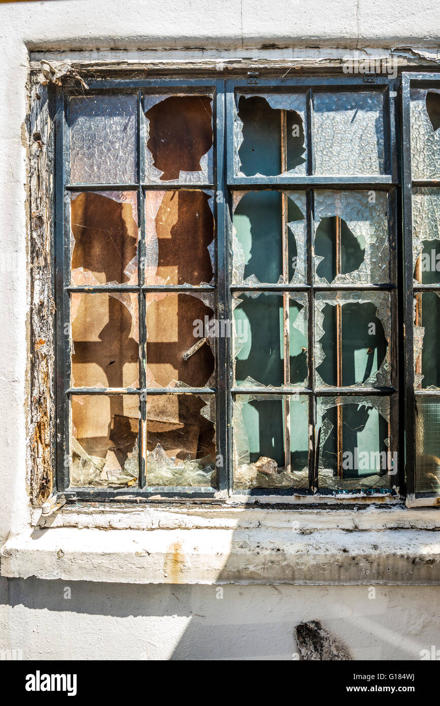 broken window on old building - Stock Image