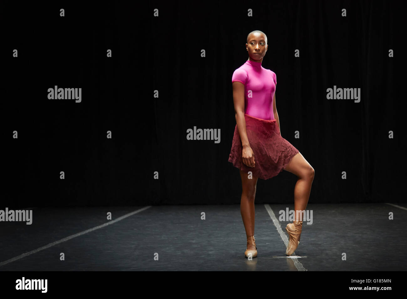 Ballet dancer with foot on tiptoe - Stock Image
