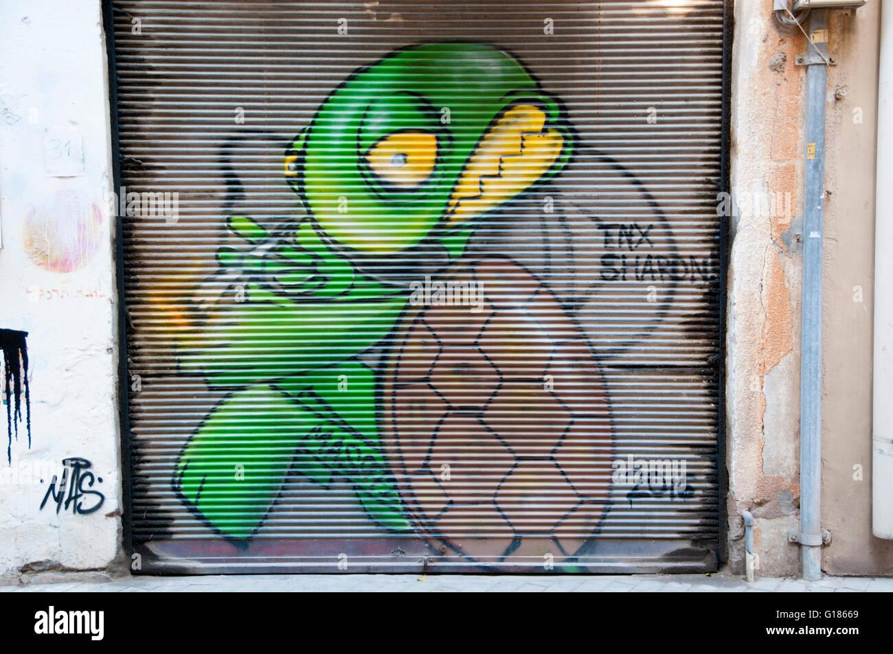 Tortoise with a joint Graffiti wall art in Florentin neighbourhood, Tel Aviv - Stock Image