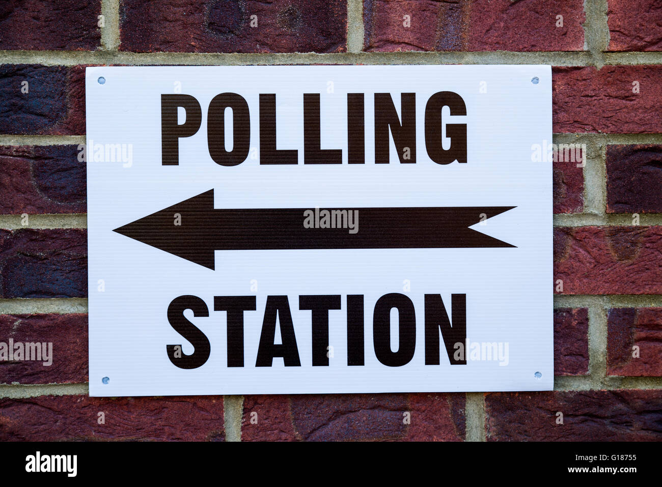 A sign outside a Polling Station on election day in the UK. - Stock Image