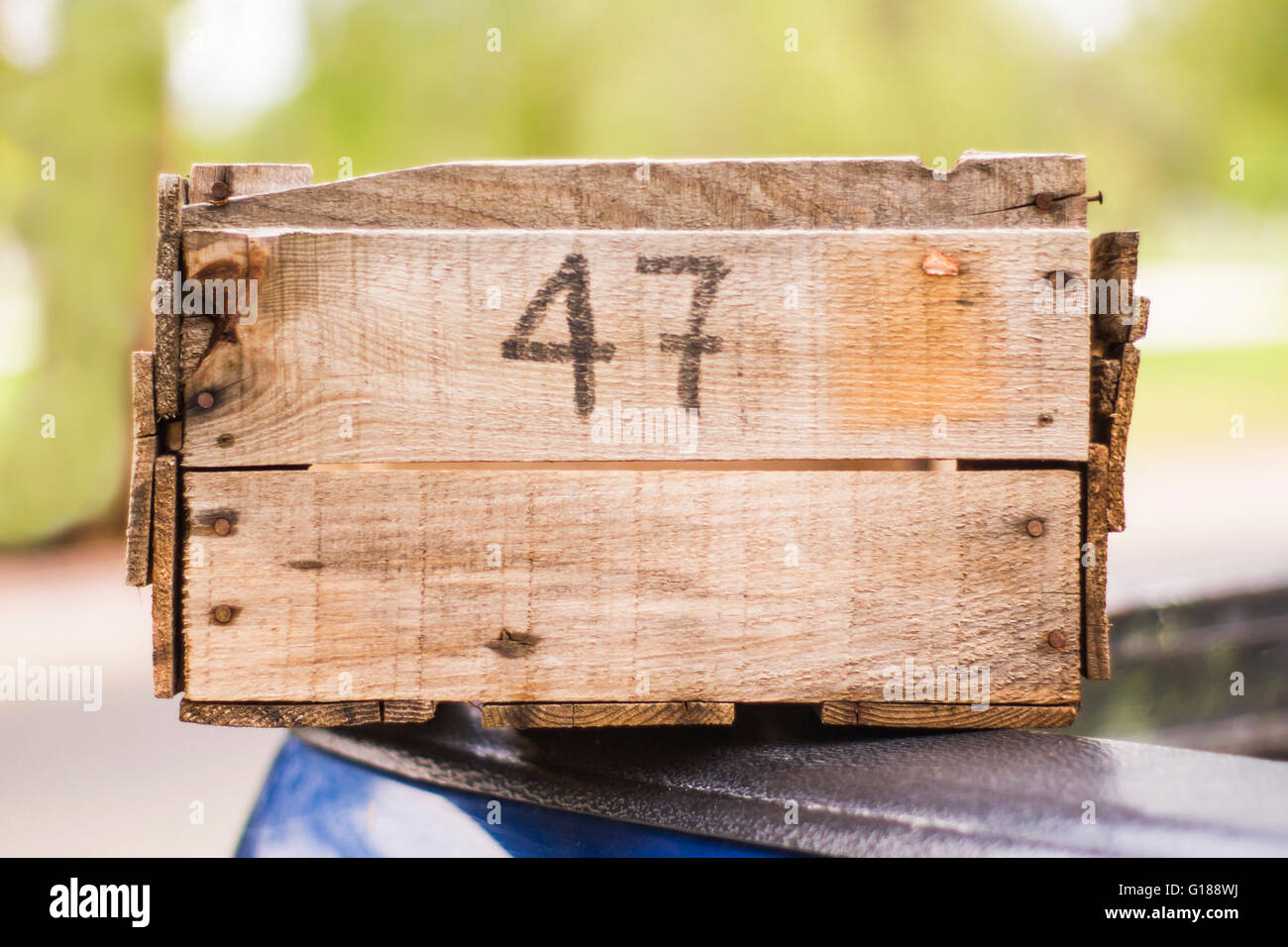 Wooden box fruit with numers in front - Stock Image