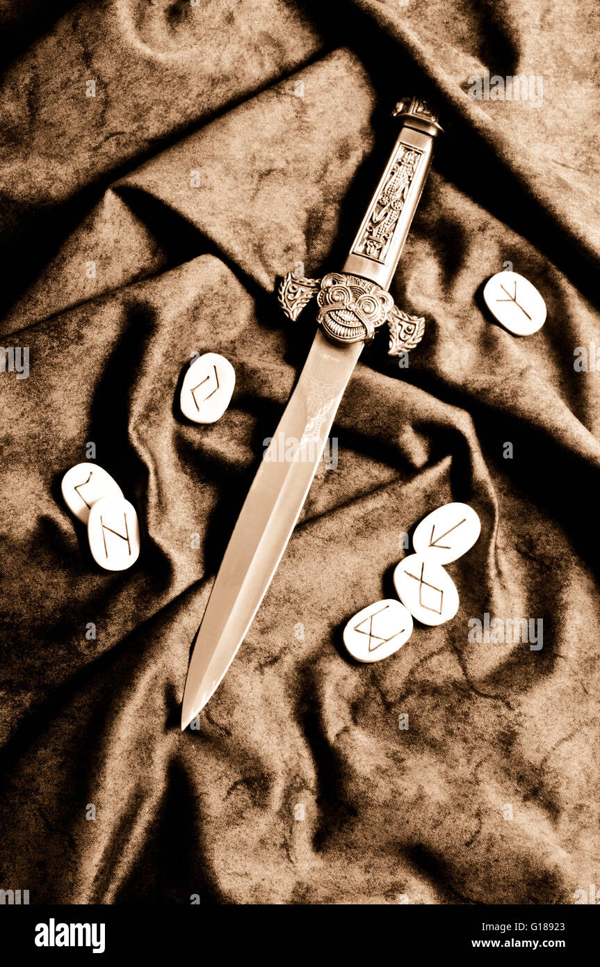 Viking dagger with runes - Stock Image