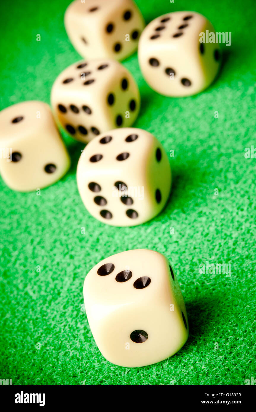 six dice on green table - Stock Image