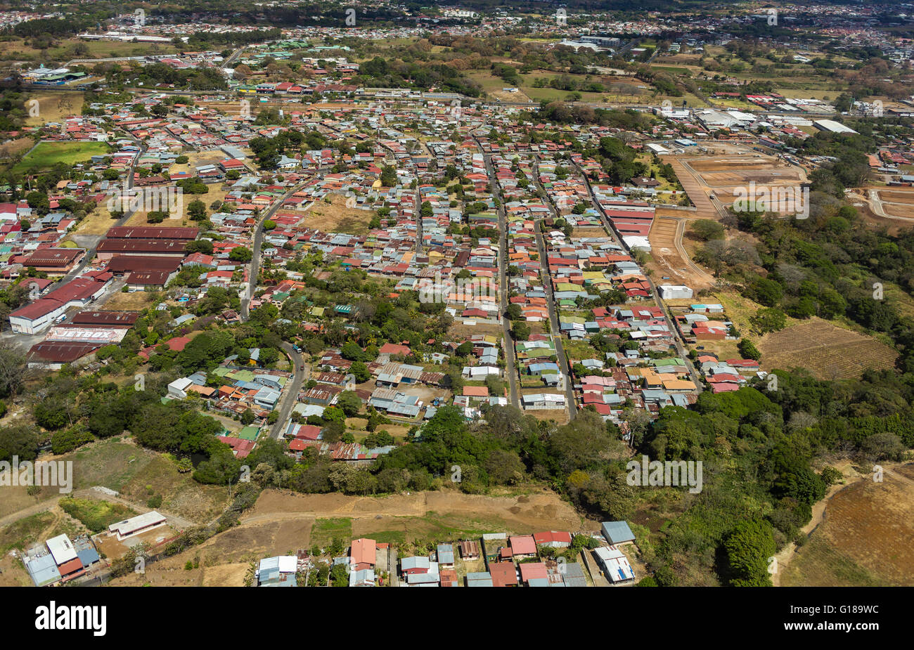 ALAJUELA, COSTA RICA - aerial view of housing and commercial activity - Stock Image