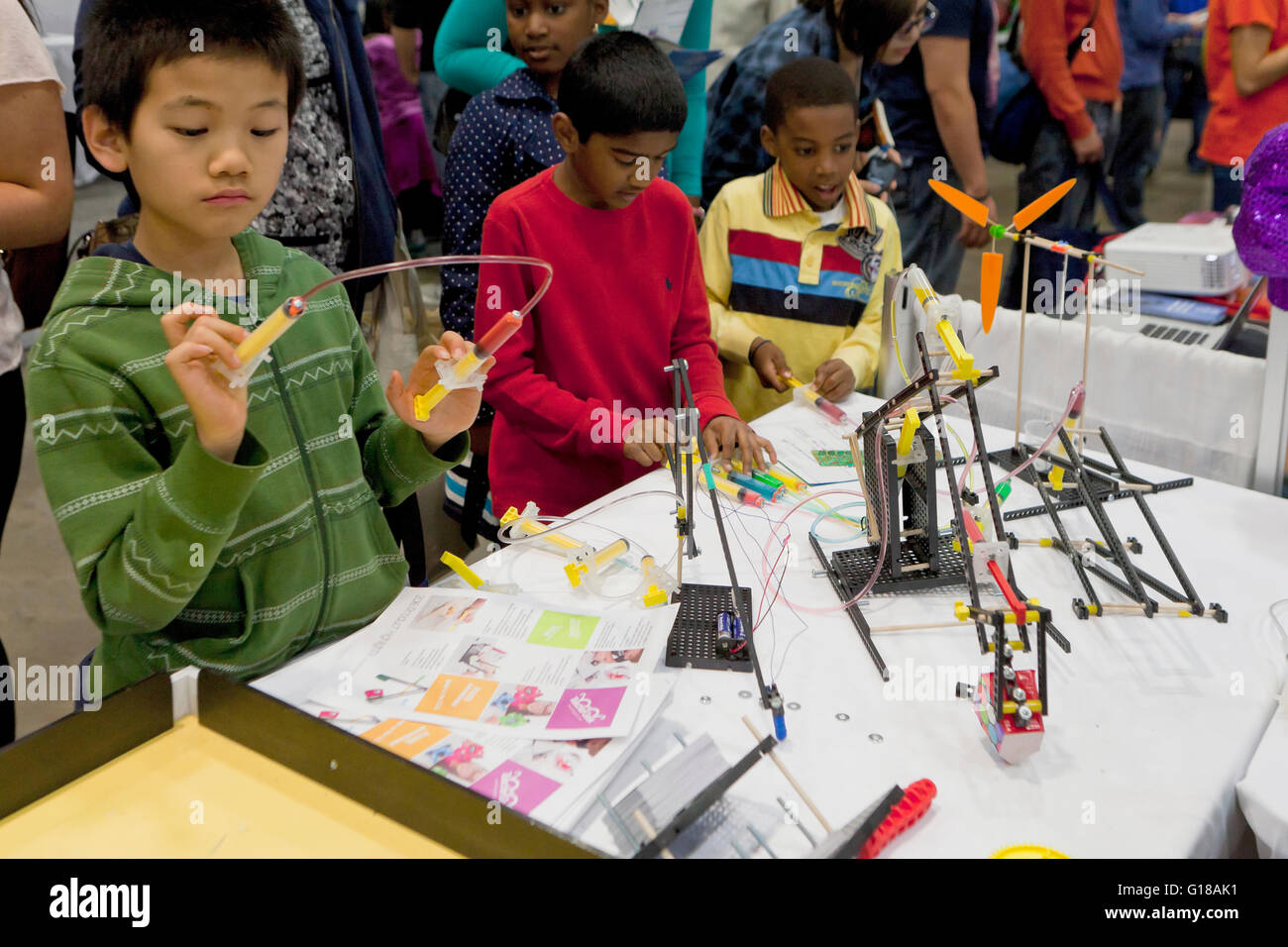 Children interacting with building toys at the USA Science and Engineering Festival - Washington, DC USA - Stock Image